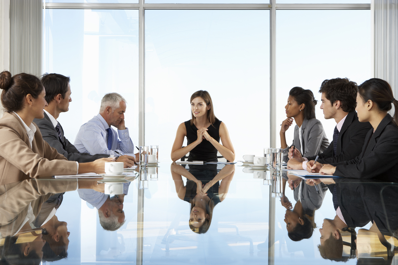executive coaching - speak up in meeting table